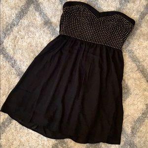 Black chiffon mini dress with gold stud